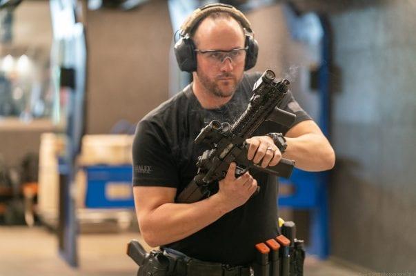 man reloading rifle