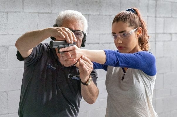 A woman taking private group classes for firearm training