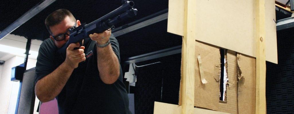 A man enjoying the battalion package and shooting a shotgun