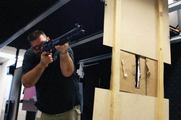 A man enjoying the battalion package and shooting a shotgun
