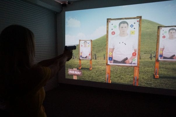 person using shooting simulator