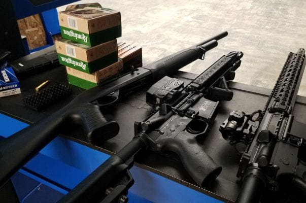 rifles and ammo on range table