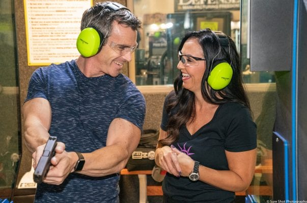 couple at the gun range after booking a course